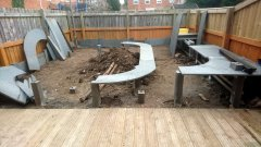 c) A few posts are in the ground and boards laid on top