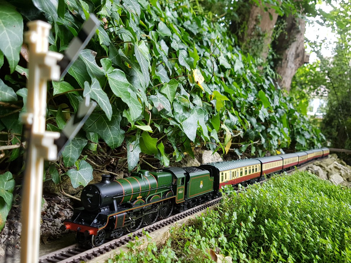 A Jubilee romps across Foxdale Bank with her passenger train...